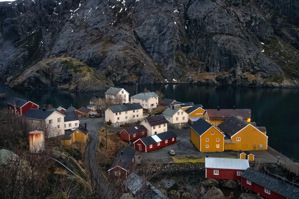 houses near lake and mountain